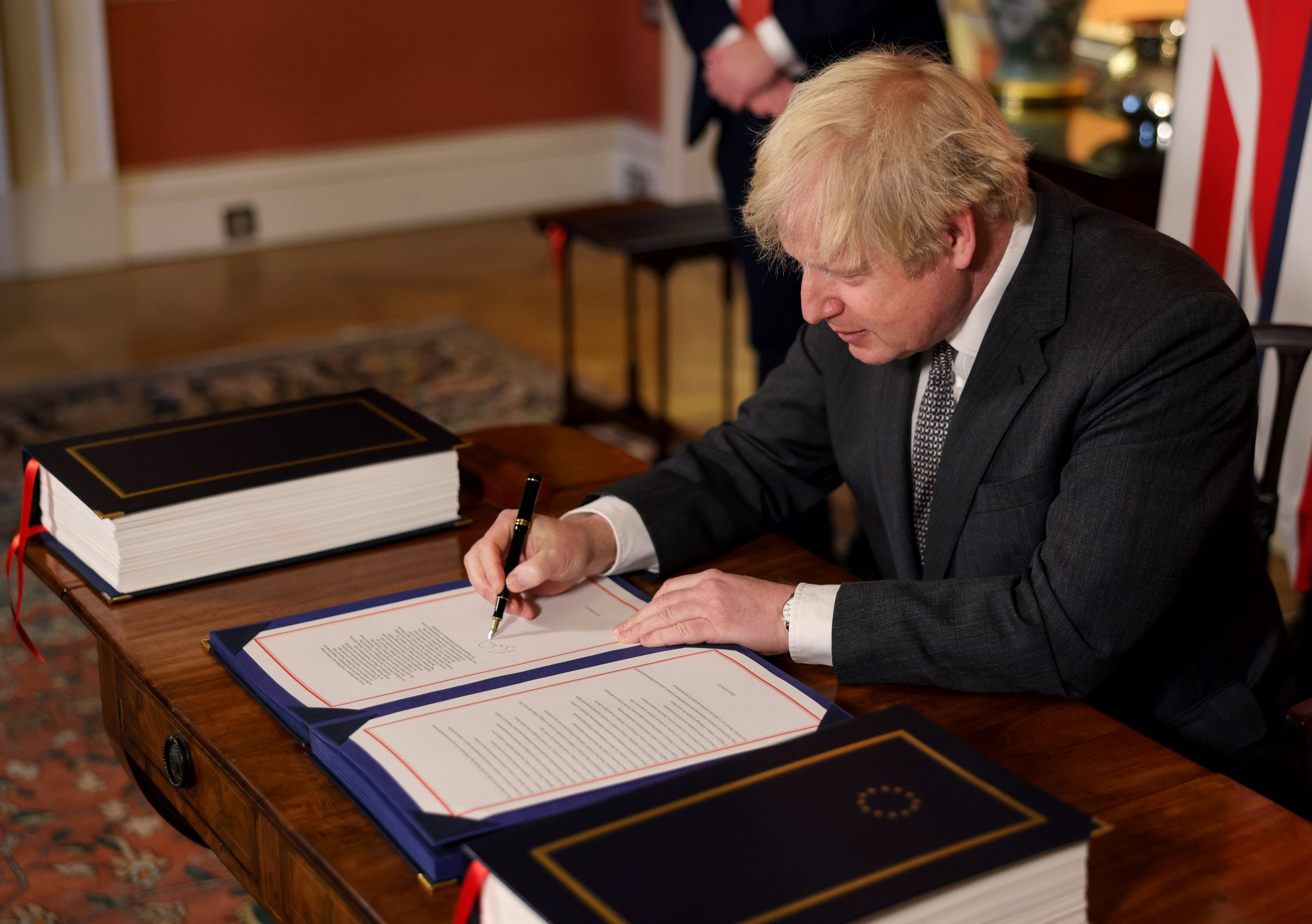 UK Prime Minister Boris Johnson has signed the post-Brexit trade deal with the European Union as the Scottish Parliament votes to reject it