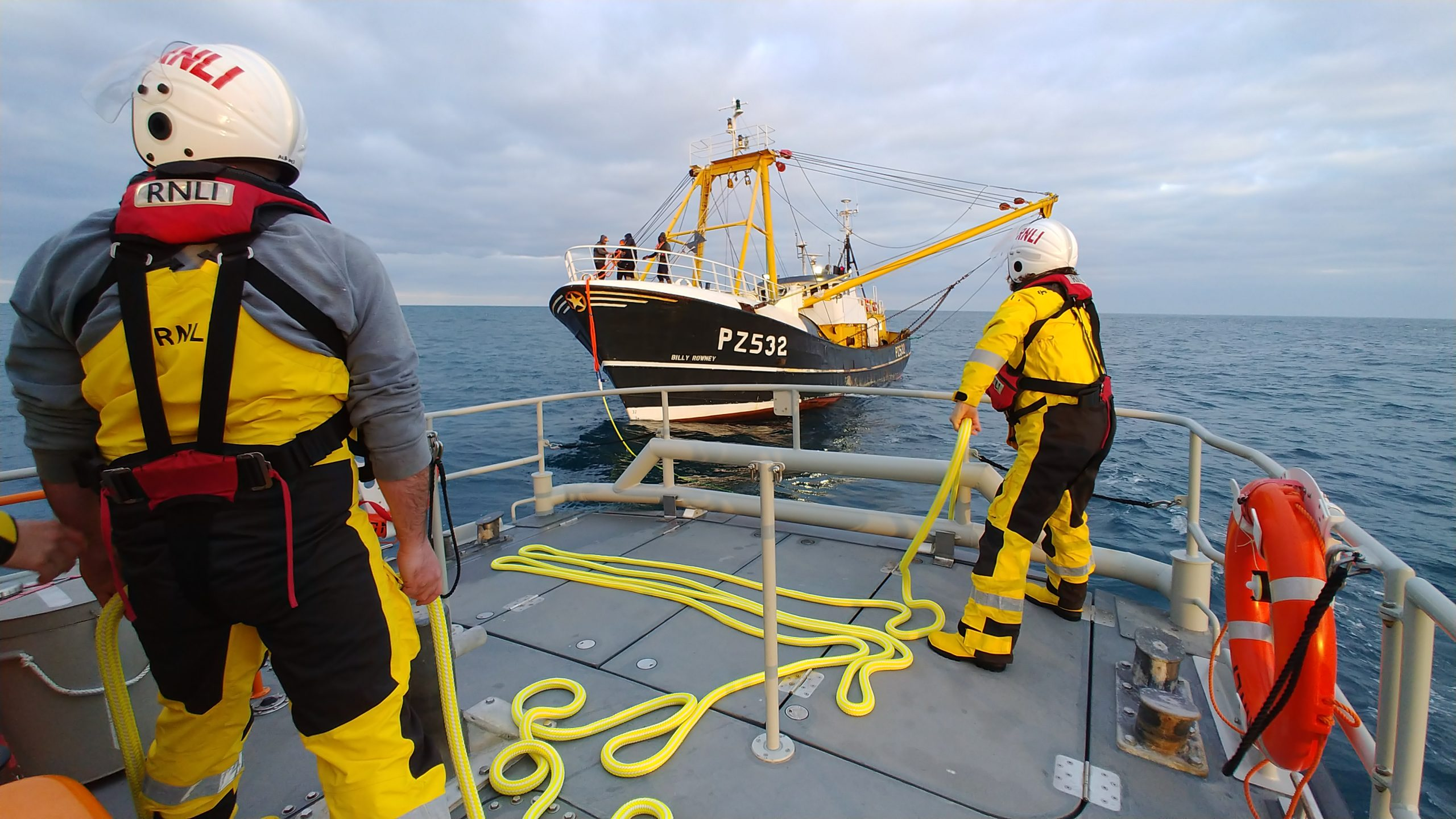 The Sennen Cove RNLI volunteers getting a line to the disabled trawler. Photo: RNLI/Rich Castle