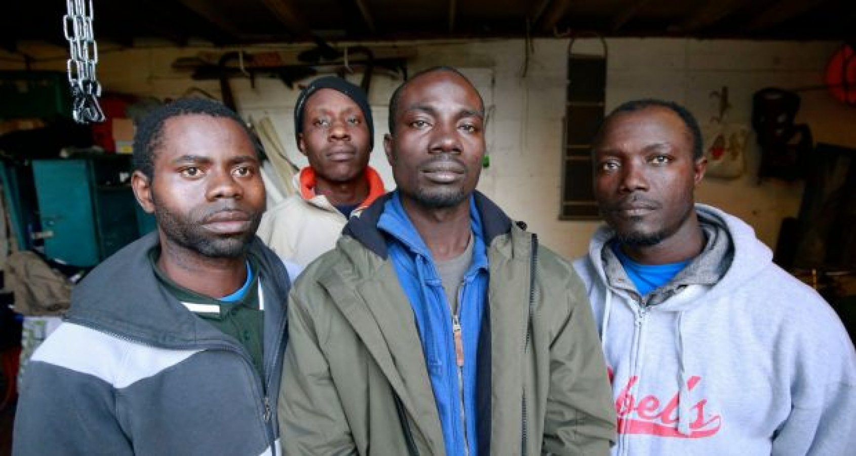 Ghanian fisher Joshua Baafi (second from left) said he is hopeful Ireland's parliament can get answers from officials who were supposed to protect workers like him   (Credit: Nick Bradshaw / The Irish Times)