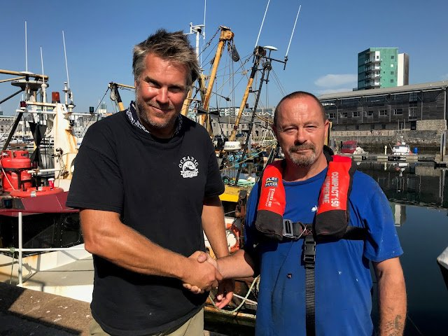 Plymouth fisherman Paul Reed, here with Oceanic Drifters director Ben Squire, has issued a stark warning after an overboard brush with death, 'A lifejacket and PLB saved my life, wear them'.